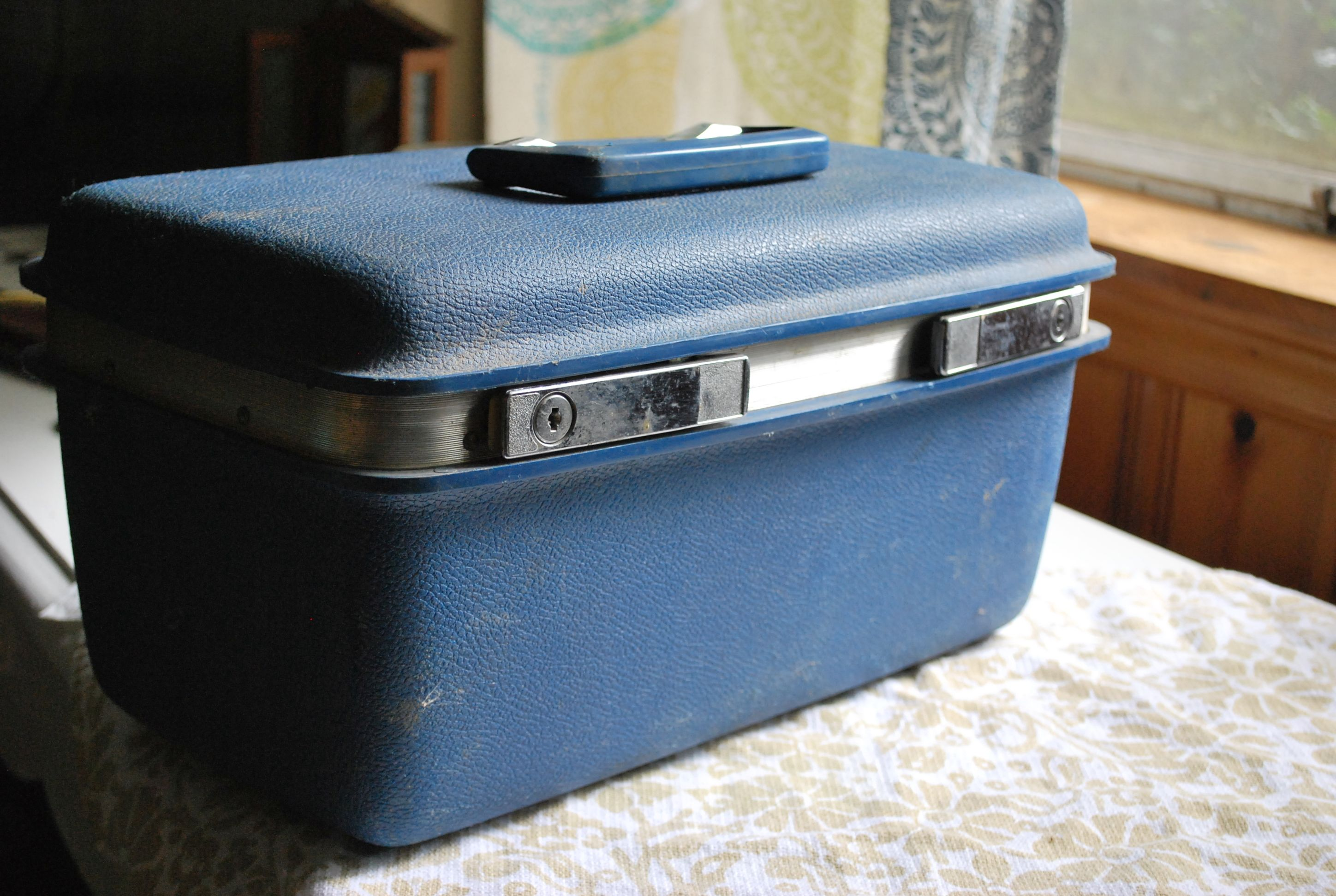Vintage luggage that will become an herbal first aid kit