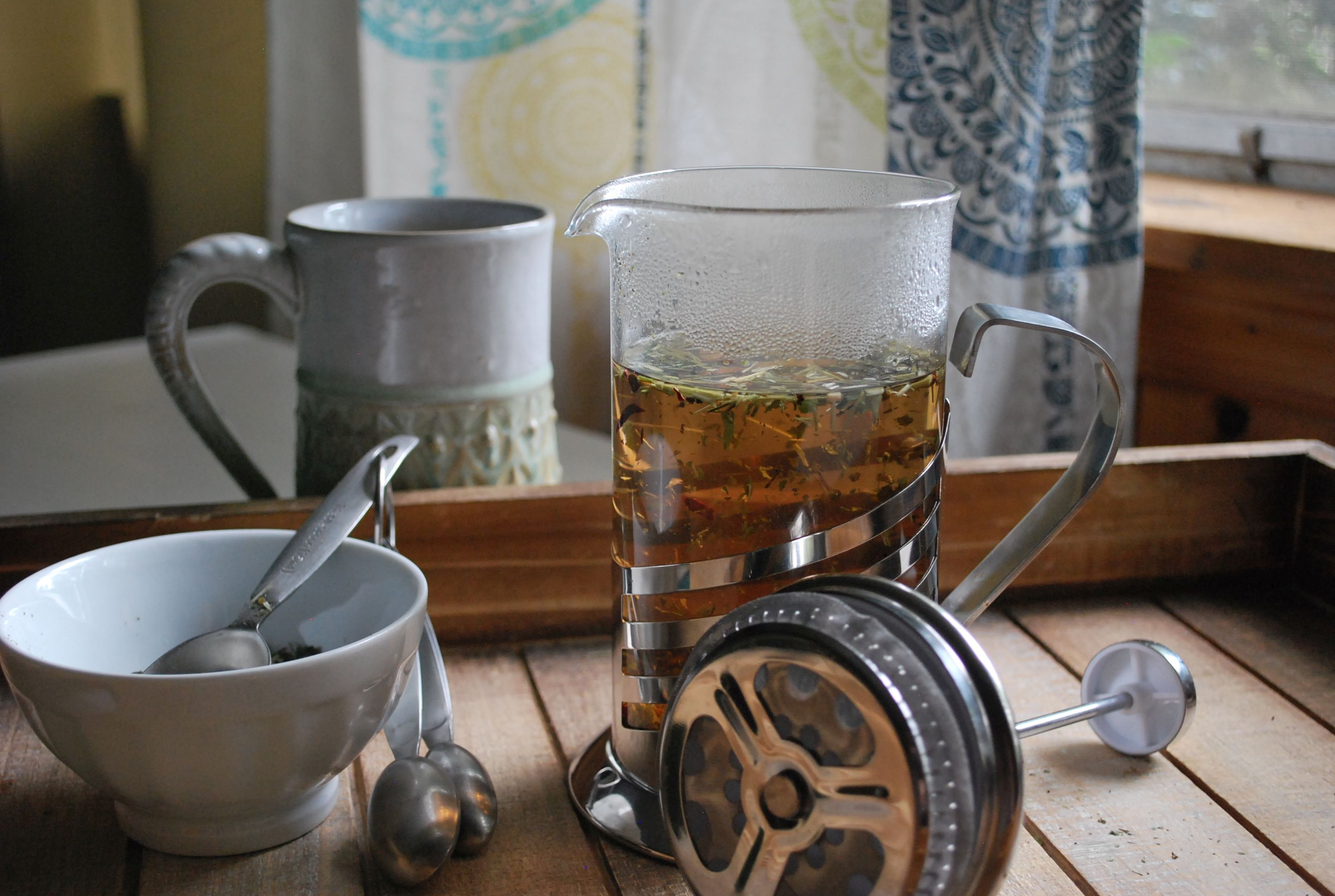 Using a French press to make herbal tea.
